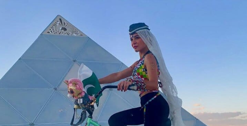 Ayesha Omar Called Out for Using Burning Man as a Backdrop In her Pictures