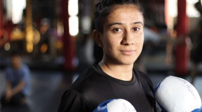 Pakistan's First MMA Fighter Anita Nisar Win a Fight in Singapore